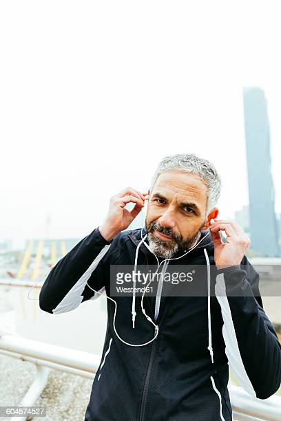 Austria, Vienna, athlete wearing earphones