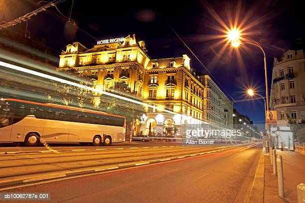 Austria, Vienna, coach travelling along road in city, night