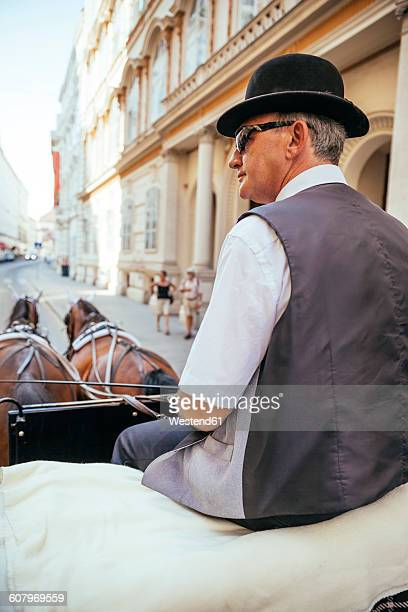 Austria, Vienna, coachman on his fiaker in the city