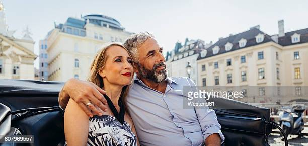 austria, vienna, couple in love on sightseeing tour in a fiaker - city break stock pictures, royalty-free photos & images