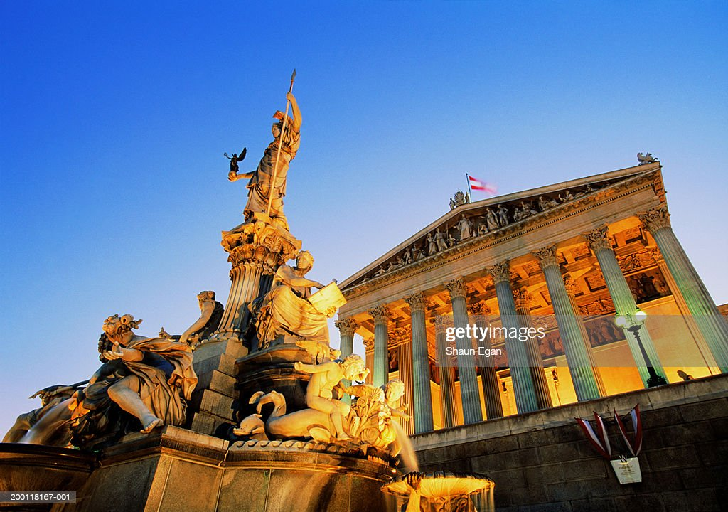 Austria, Vienna, Pallas Athene Fountain and Parliament, low angle view : Stock Photo