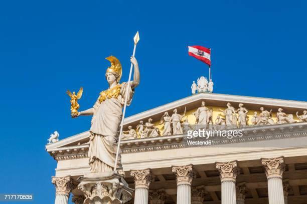 austria, vienna, parliament, statue pallas athene, austrian flag - austrian culture stock pictures, royalty-free photos & images