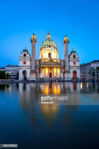 austria, vienna, st. charles's church, blue hour - vienna austria stock pictures, royalty-free photos & images