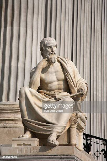 Austria, Vienna, Statue of the Greek philosopher Herodotus in front of columns of the Parliament Building.