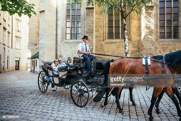 austria, vienna, tourists on sightseeing tour in a fiaker - carriage stock pictures, royalty-free photos & images