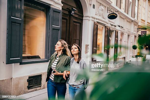 Austria, Vienna, two female friends exploring the old town
