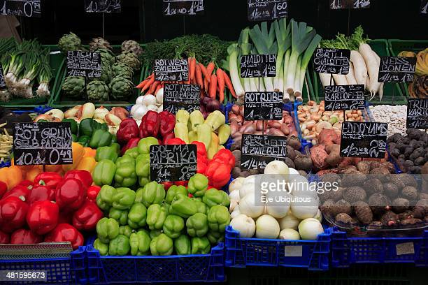 Austria Vienna Vegetable stall in the Naschmarkt with display of produce including red and green peppers leeks and artichokes