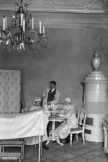 Austria Vienna Vienna Invalids home in the Castle Schoenbrunn a physician and two nurses in the former parlour in the Valerie tract 1922 Photographer...