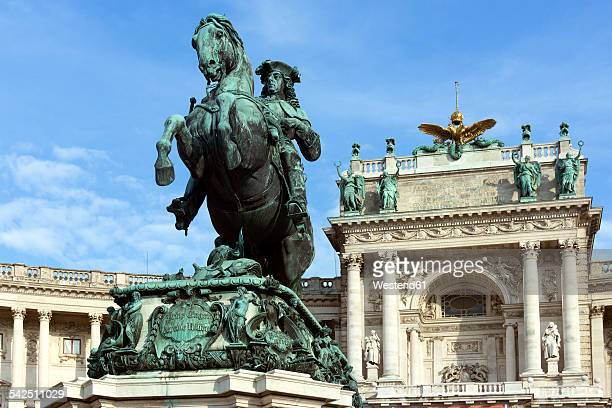 Austria, Vienna, view to lighted Hofburg Palace and Equeatrian Sculpture Prince Eugen in the foreground