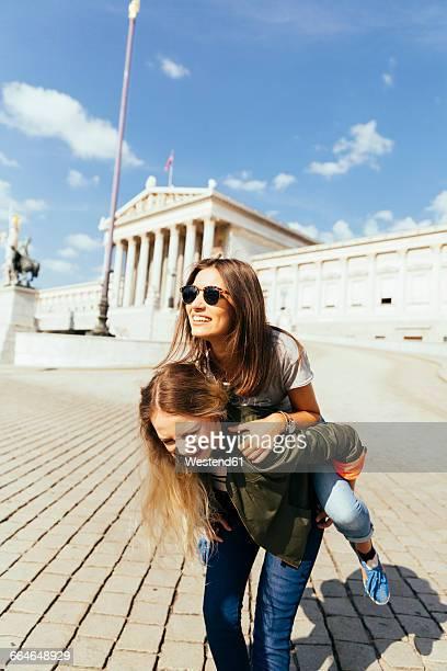 Austria, Vienna, women in front of Parliament building