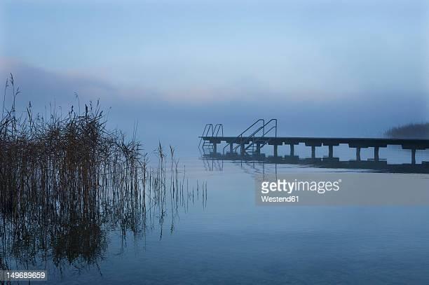 Austria, View of foggy Mondsee Lake during autumn