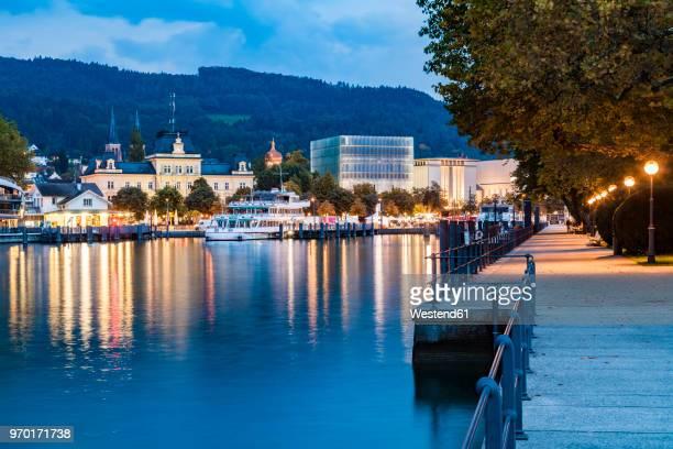 austria, vorarlberg, bregenz, lake constance, harbour, lakeside promenade, kunsthaus bregenz in the evening - vorarlberg stock photos and pictures