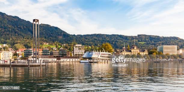 austria, vorarlberg, bregenz, lake constance, harbour with tourboat, kunsthaus bregenz in the background - vorarlberg stock-fotos und bilder