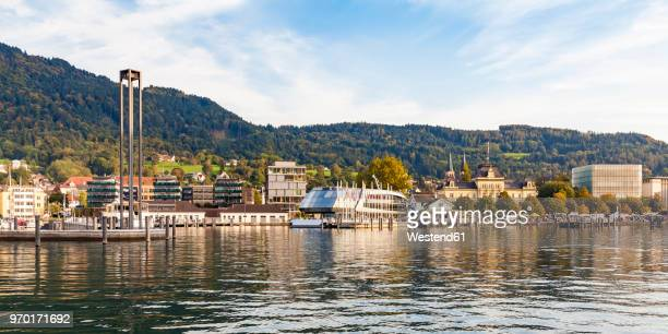austria, vorarlberg, bregenz, lake constance, harbour with tourboat, kunsthaus bregenz in the background - vorarlberg stock photos and pictures