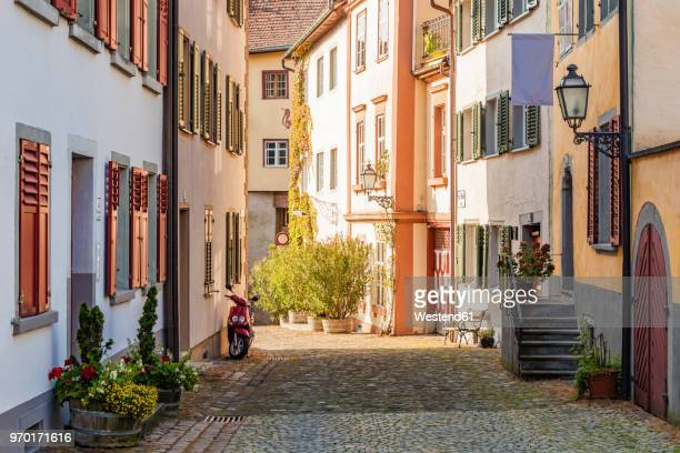 austria, vorarlberg, bregenz, upper city, alley and row of old houses - vorarlberg stock-fotos und bilder