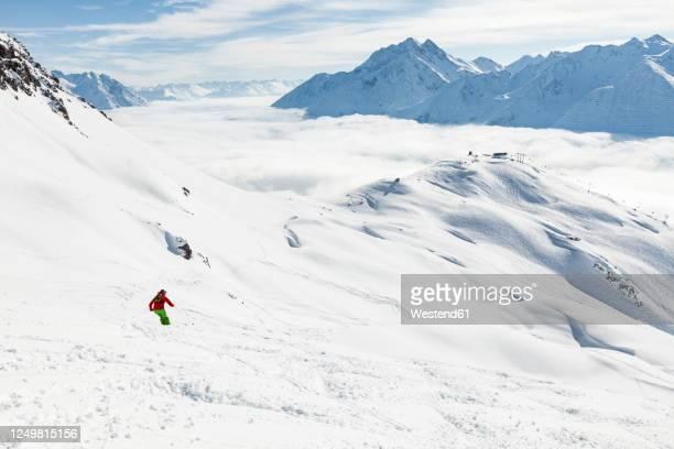austria, vorarlberg, man skiing in arlberg massif - フォアアールベルク州 ストックフォトと画像