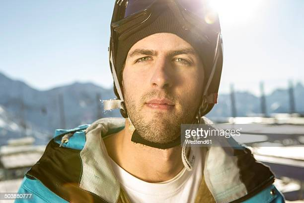 austria, vorarlberg, riezlern, portrait of young man wearing ski goggles - ski goggles stock pictures, royalty-free photos & images