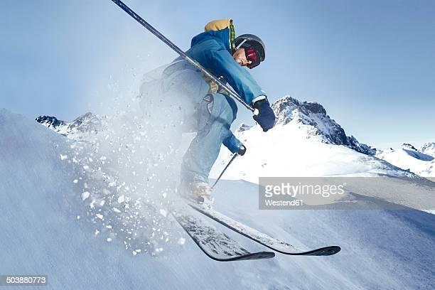 Austria, Vorarlberg, Riezlern, Skier in motion