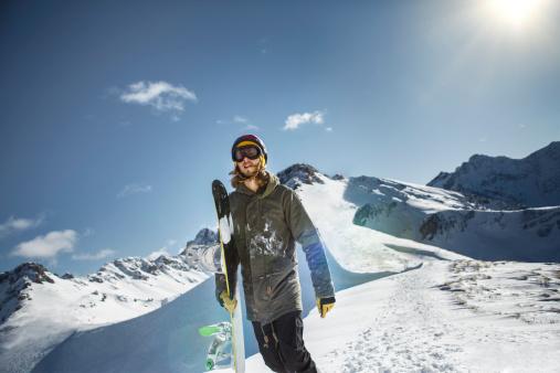 Austria, Vorarlberg, Riezlern, Snowboarder in the mountains - gettyimageskorea