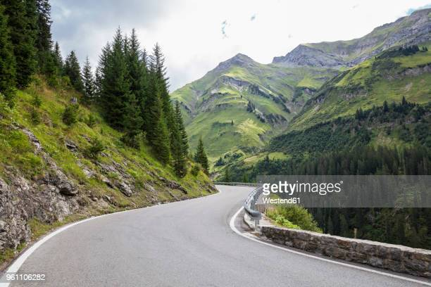 austria, vorarlberg, winding narrow alpine road from warth to lech, lech valley - vorarlberg foto e immagini stock