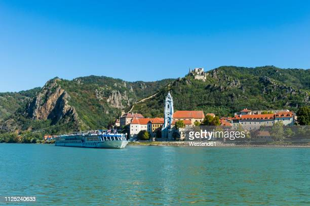 austria, wachau, cruise ship passing duernstein on the danube - danube river stock pictures, royalty-free photos & images
