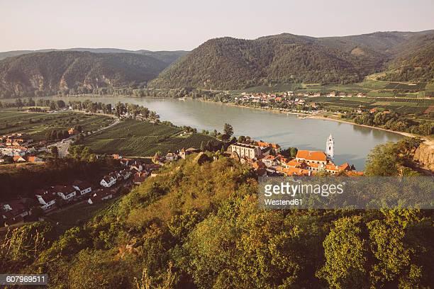 Austria, Wachau, Duernstein, Duernstein monastery with blue spire at Danube river