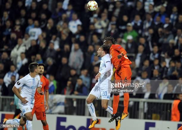 Austria Wien's defender Abdul Kadiri Mohammed vies with Rijeka's forward Alexander Gorgon during the UEFA Europa League Group D football match...