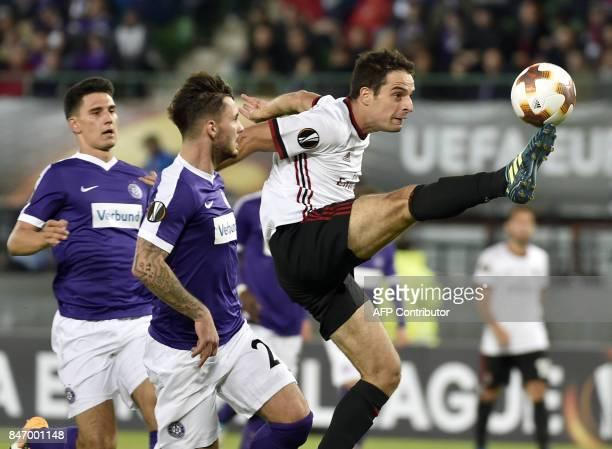Austria Wien's defender from Austria Alexander Borkovic Austria Wien's defender from Austria Christoph Martschinko and AC Milan's midfielder from...