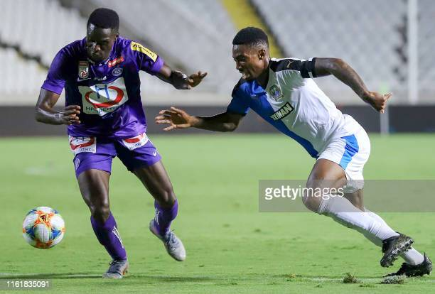 Austria Wien's defender Maudo Jarjue vies for the ball with Apollon's forward Serge Gakpe during the UEFA Europa League football match between...