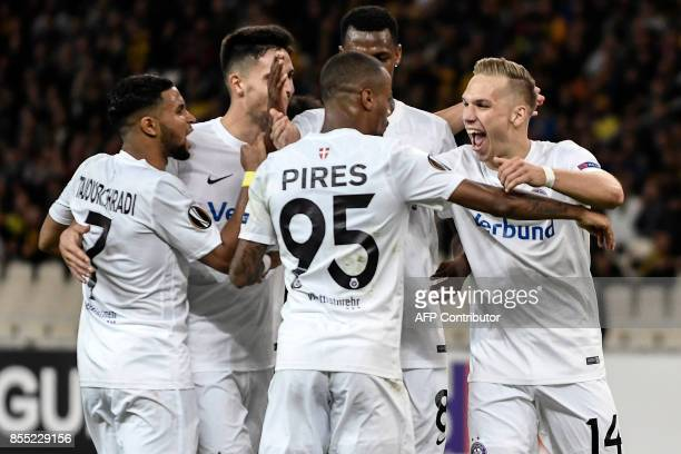 Austria Wien's forward Christoph Monschein celebrates with teammates after scoring a goal during the UEFA Europa League Group D football match...