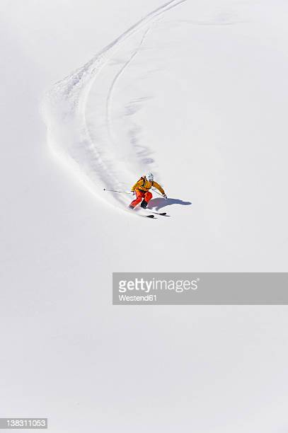 austria, young woman doing alpine skiing - skifahren stock-fotos und bilder