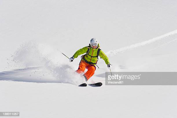 Austria, Young woman doing alpine skiing