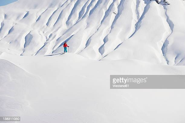 austria, zurs, lech, young woman doing alpine skiing on arlberg mountain - lech stock photos and pictures