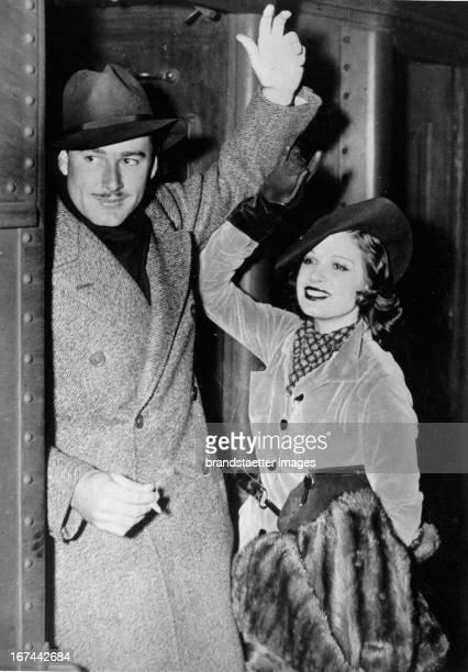 Austrialian actro Errol Flynn and the French actress Lily Damita at their arrival in New York 1935 Photograph Der australische Schauspieler Errol...