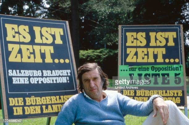 Austrian actor and politician Herbert Fux with some election posters, Austria 1970s.