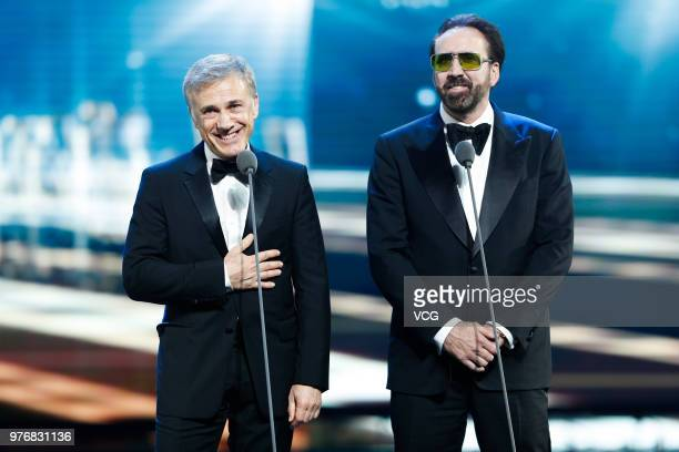 Austrian actor Christoph Waltz and American actor Nicolas Cage attend the opening ceremony of the 21st Shanghai International Film Festival at...