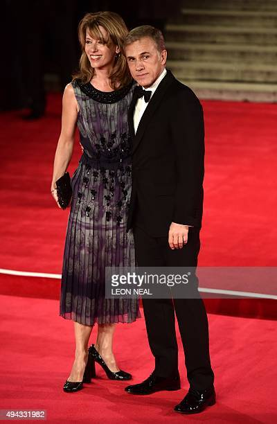 Austrian actor Christoph Waltz and his wife Judith Holste pose on arrival for the world premiere of the new James Bond film 'Spectre' at the Royal...