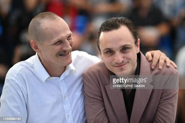 """Austrian actor Georg Friedrich and German actor and dancer Franz Rogowski pose during a photocall for the film """"Great Freedom"""" as part of the Un..."""