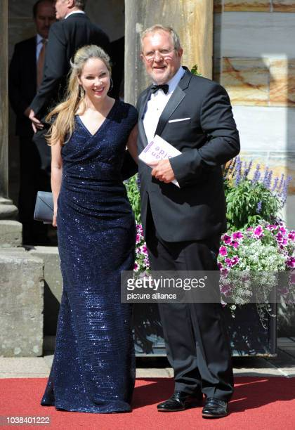 Austrian actor Harald Krassnitzer and his wife AnnKathrin Kramer arrive for the opening of the 104th Bayreuth Festival in Bayreuth Germany 25 July...