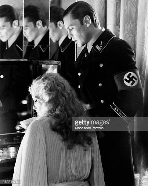 Austrian actor Helmut Berger and Swedish actress Ingrid Thulin acting in the film 'Salon Kitty' Rome 1975