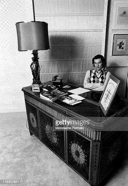 Austrian actor Helmut Berger lying on a double bed Rome 1972