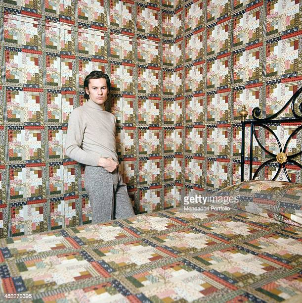 Austrian actor Helmut Berger posing in the guest room of his house Rome 1972
