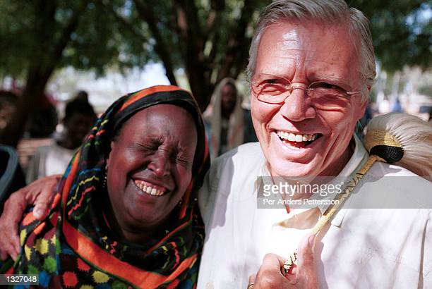 Austrian actor KarlHeinz Bohm hugs Nuria Hussein February 8 2001 with whom he works with for his organization Menschen for Menschen in Harar in the...