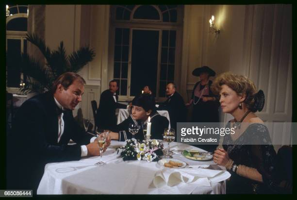 Austrian actor Klaus Maria Brandauer young David Eberts and American actress Faye Dunaway perform on the set of the 1988 movie Burning Secret or...