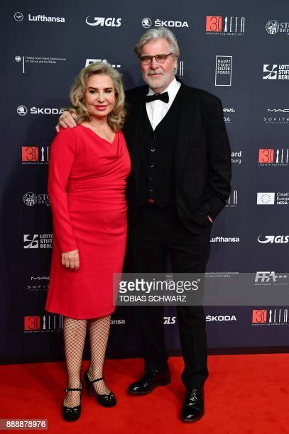 Austrian actor Peter Simonischek and his wife Austrian actress Brigitte Karner pose upon arrival for the 30th European Film Awards in Berlin on...