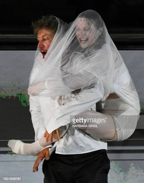 Austrian actor Tobias Moretti as 'Jedermann' and Mavie Hoerbiger as 'Werke' perform on stage during a rehearsal of Hugo von Hofmannsthal's drama...