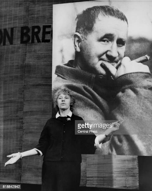 Austrian actress and singer Lotte Lenya standing in front of a photograph of Bertolt Brecht during rehearsals for the English State Company's...