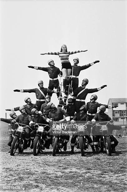 Austrian actress Eva ReuberStaier winner of the Miss World 1969 contest posing with the Royal Marines motorcycle display team UK 3rd June 1971