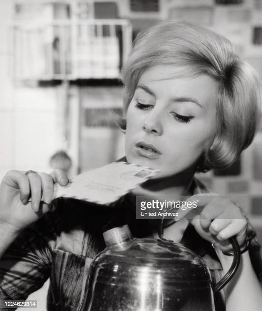 Austrian actress Heidelinde Weis opening a letter with water steam Germany 1960s