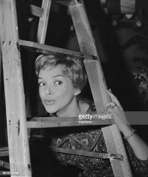 Austrian actress Herta Staal rehearses for the comedy 'My Sister and I' in a Hamburg shoe shop Germany March 1960 She stars with Peter Garden and Edy...